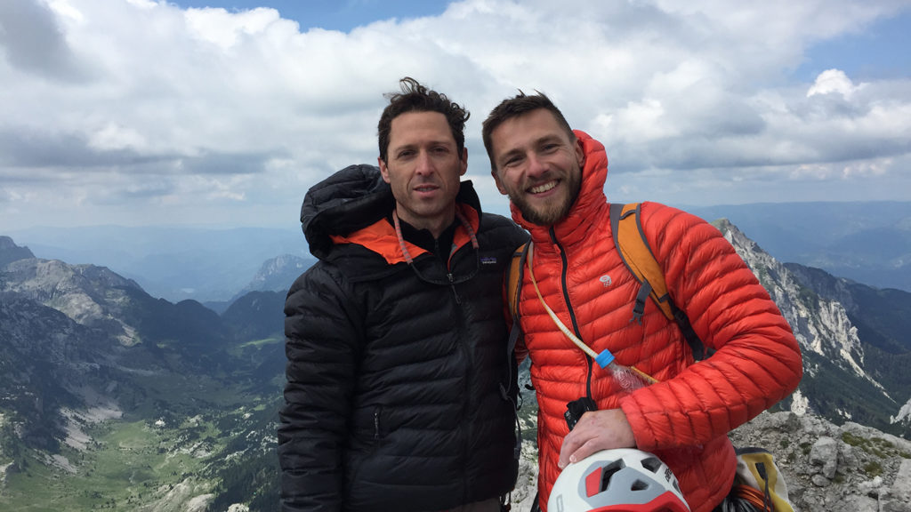 Matthew Arevian poses with another climbed in Bosnia