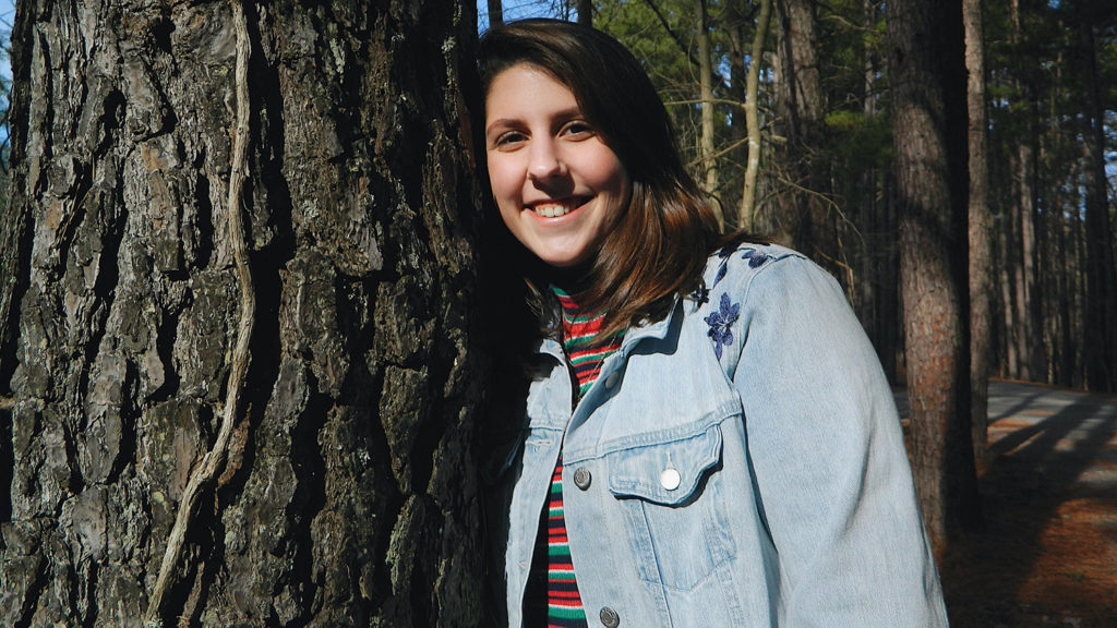 Caroline Zuber poses by tree