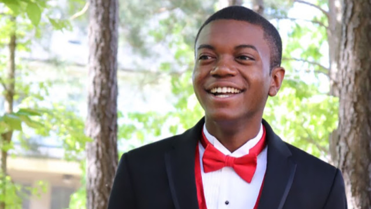 Student poses in tuxedo