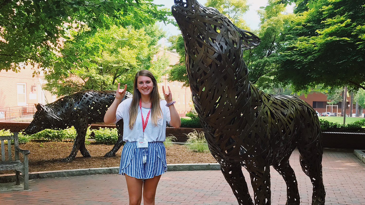 Student poses in Wolf Plaza