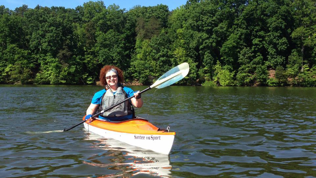 Adriene Heffner kayaking on a lake: A Student at 50: a Non-Traditional Journey in the College of Natural Resources