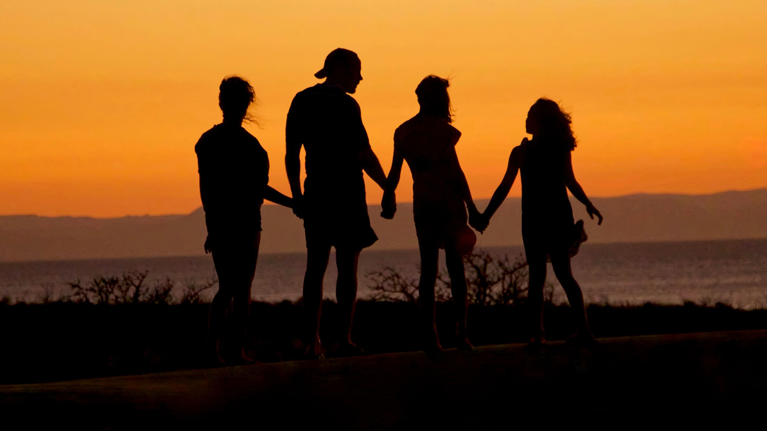family in silhouette - How Kids Are Inspiring Adults to Address Climate Change - College of Natural Resources News NC State University