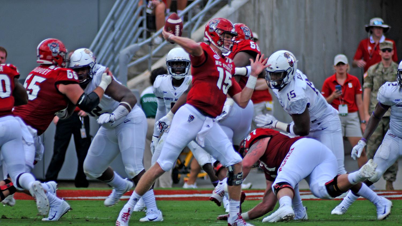 Wolfpack quarterback Ryan Finley (15) rears back to throw against JMU.