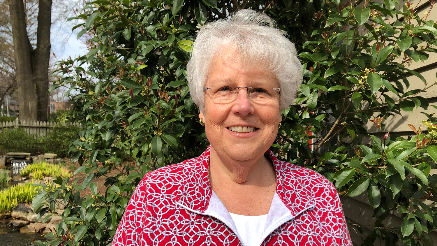 watzin poses in front of yellow flowers - Women in Natural Resources: Forestry Professor Mary Watzin - College of Natural Resources News NC State University
