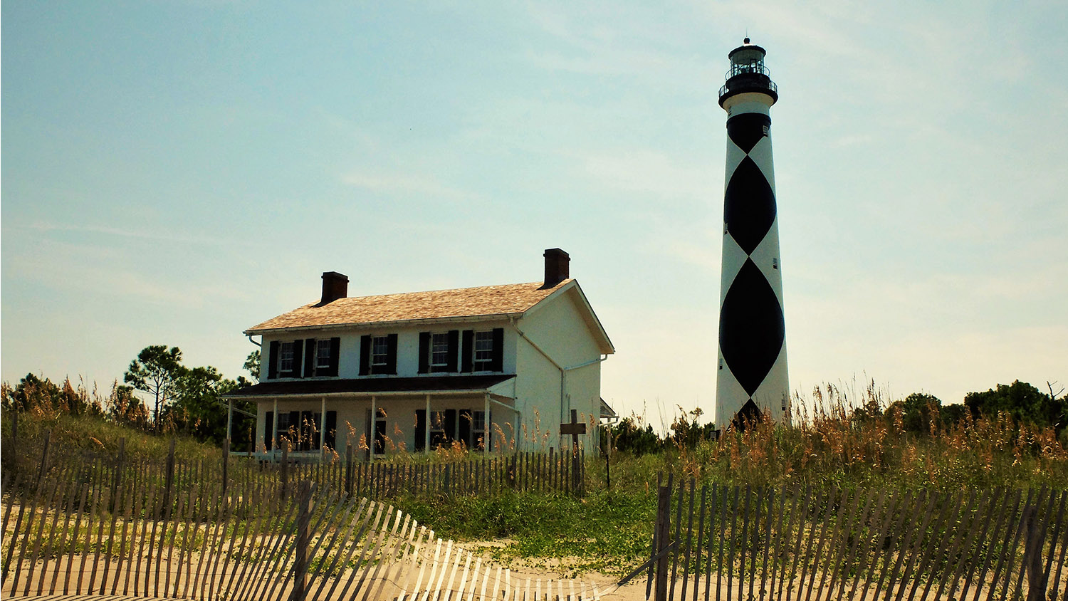 Lighthouse Next to a House - Extension and Outreach - Parks Recreation and Tourism Management NC State