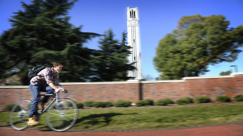 Belltower and biking student