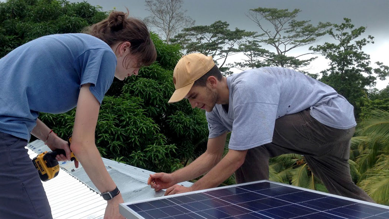 Students installing solar panels - Interdisciplinary Graduate Degrees - College of Natural Resources at NC State University
