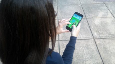 Student playing Pokemon Go