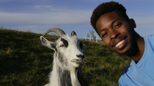 Corey-Aydlett selfie with a goat - Environmental First Year Program - College of Natural Resources at NCState University