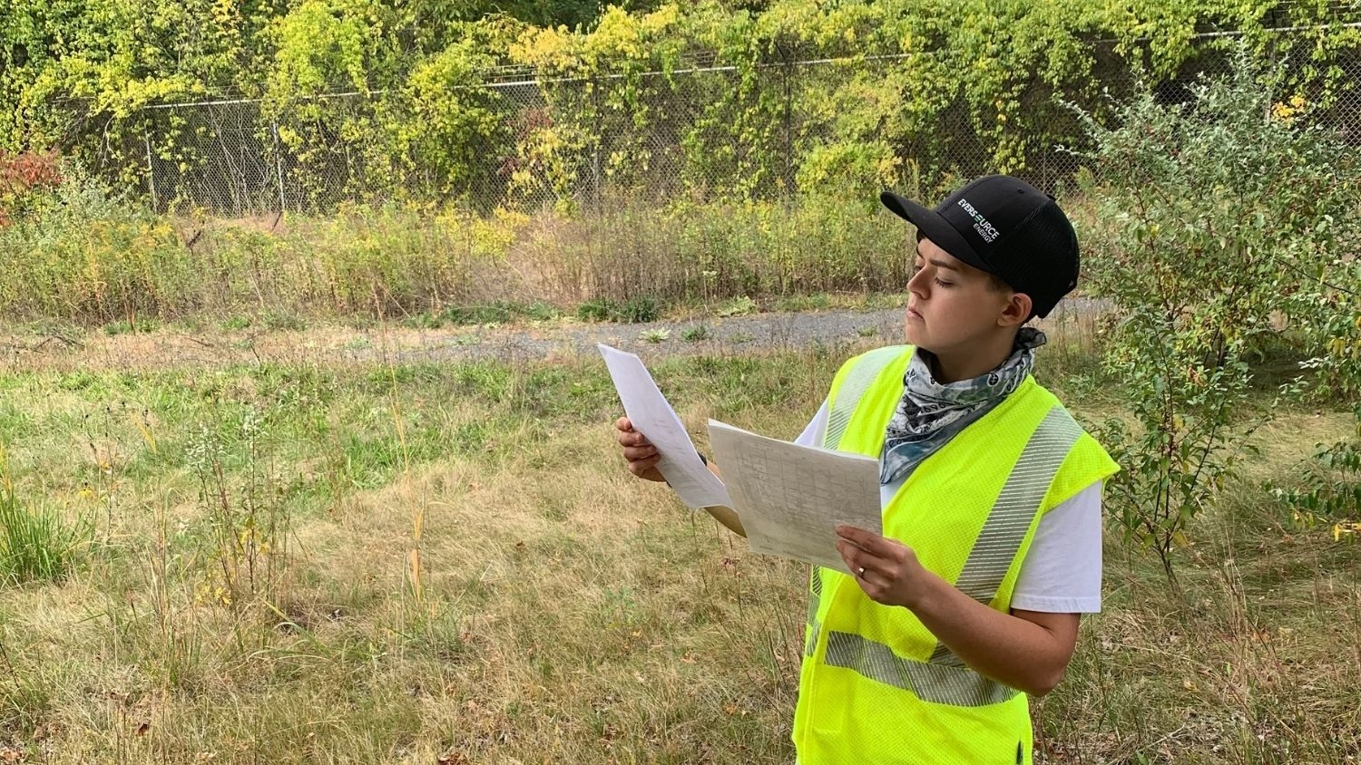 Reading Document in Field - Five Questions with Environmental Specialist Deanna Sassorossi - College of Natural Resources at NCState University
