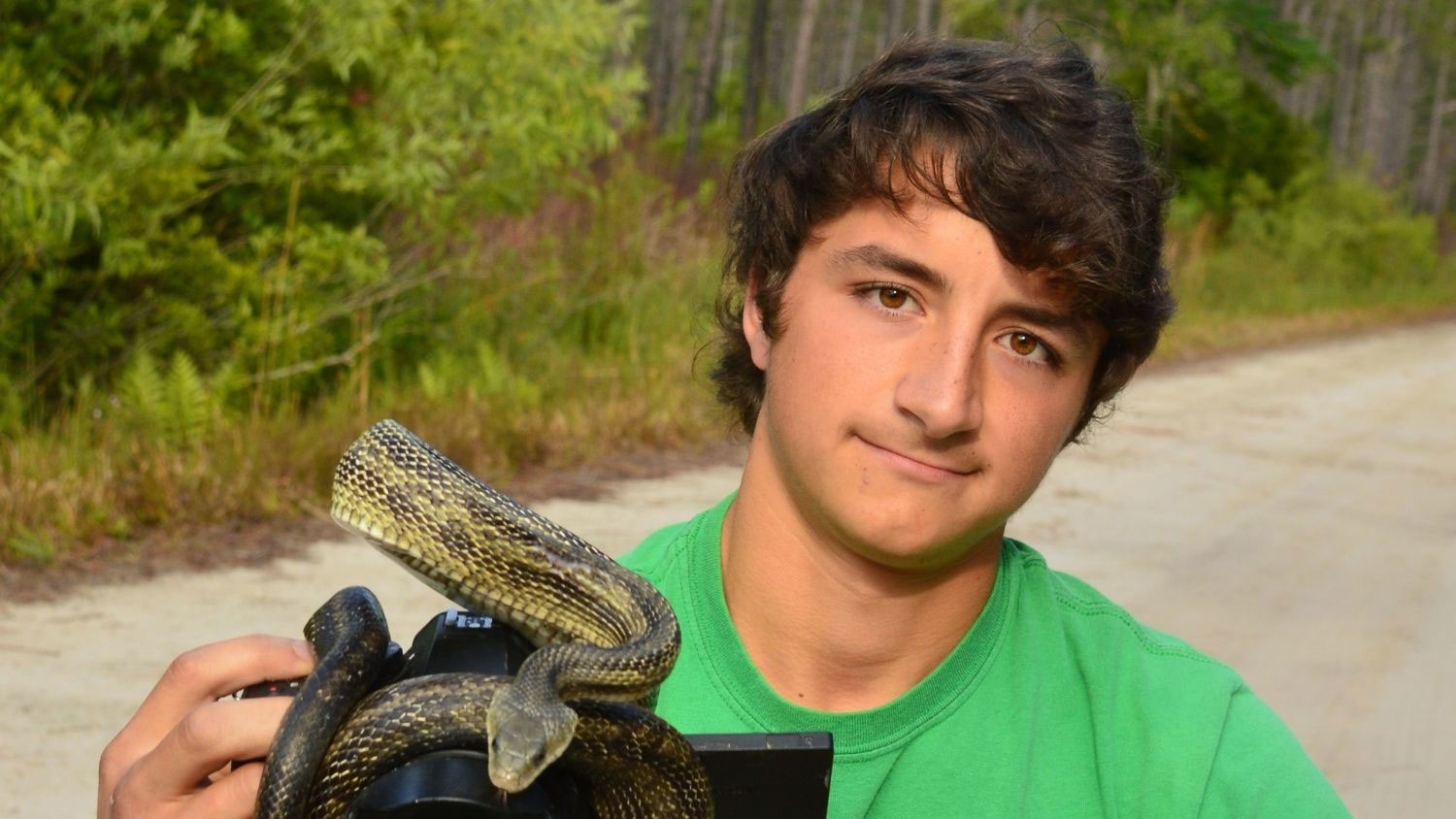 Ben Zino with a snake - CNR Student Ben Zino Promoting Wildlife Conservation One Video at a Time - College of Natural Resources at NCState University
