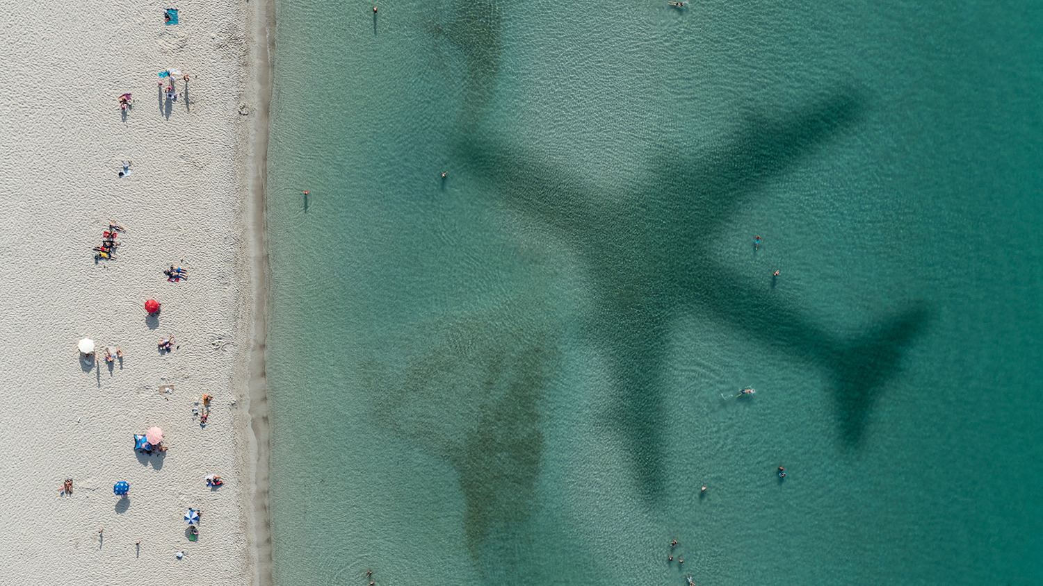 Plane Shadow in Ocean - Ask an Expert: What is Sustainable Tourism? - College of Natural Resources at NC State University